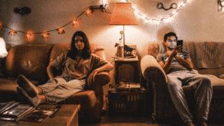 Rita (Geraldine Viswanathan) and Ravi (Karan Soni) sitting with each other