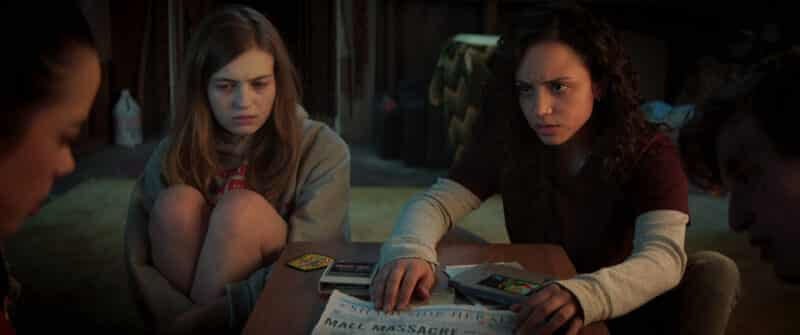 Sam (Olivia Scott Welch) and Deena (Kiana Madeira) learning about Shadyville's history