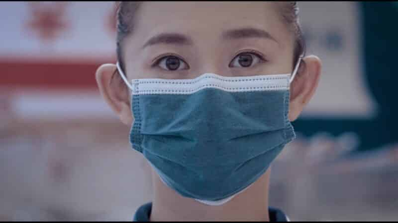 The Girl (Li Chao) taking the boy's temperature