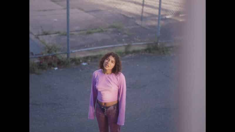 Violet (Sariah Saibu) outside of Blue's window