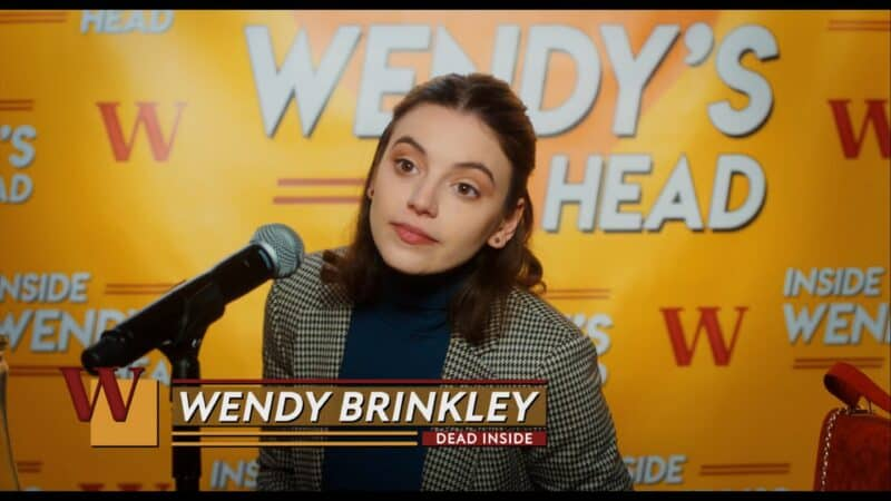 Wendy (Francesca Reale) in a post-date interview