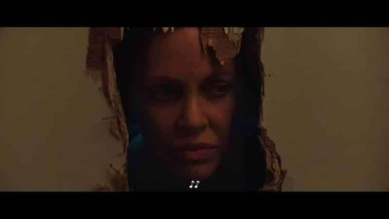 Ms. Burton (Kristin Bauer van Straten) breaking through her bathroom door, with an axe, to get to Bobby