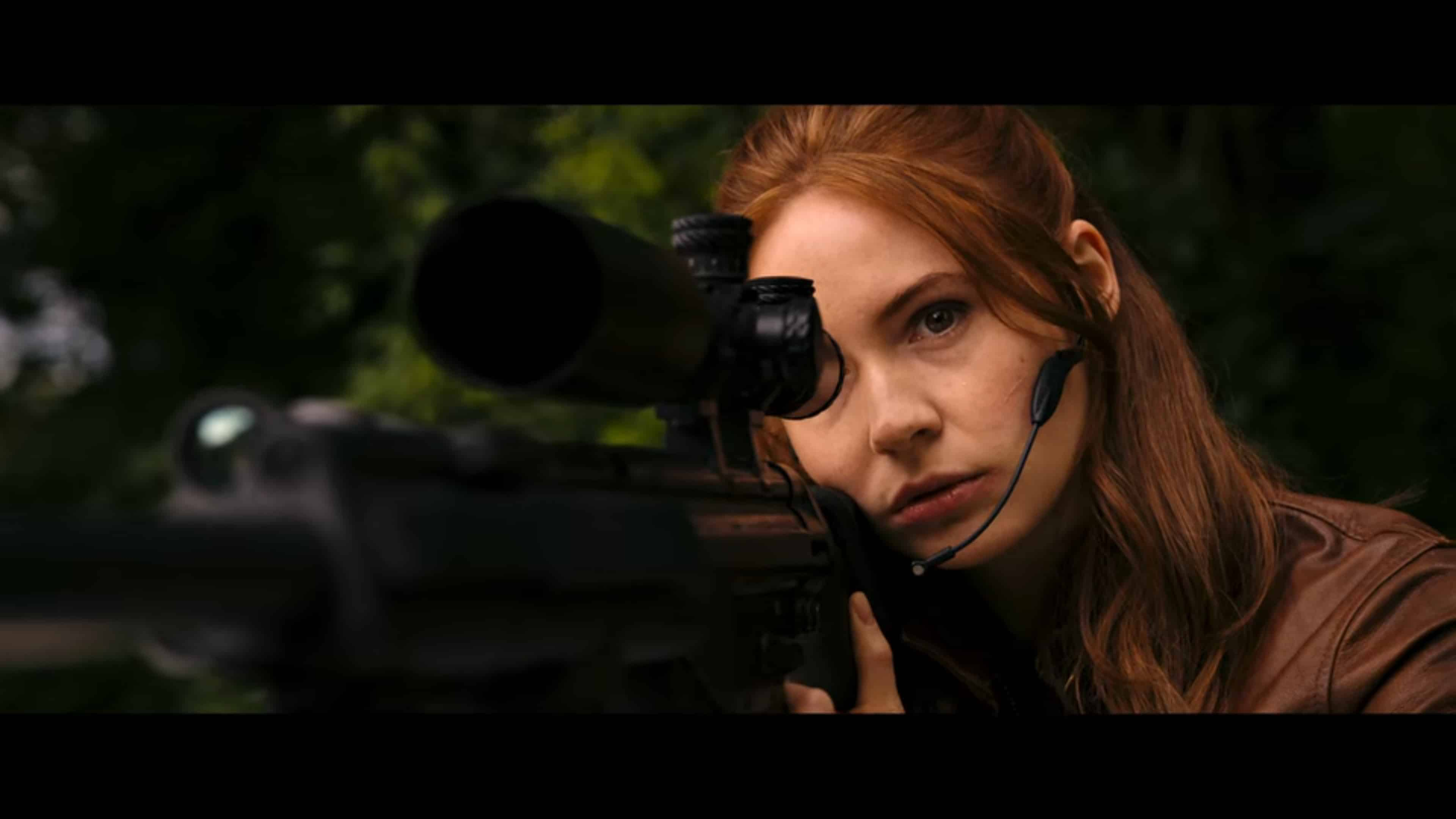 Sam (Karen Gillian) with a rifle