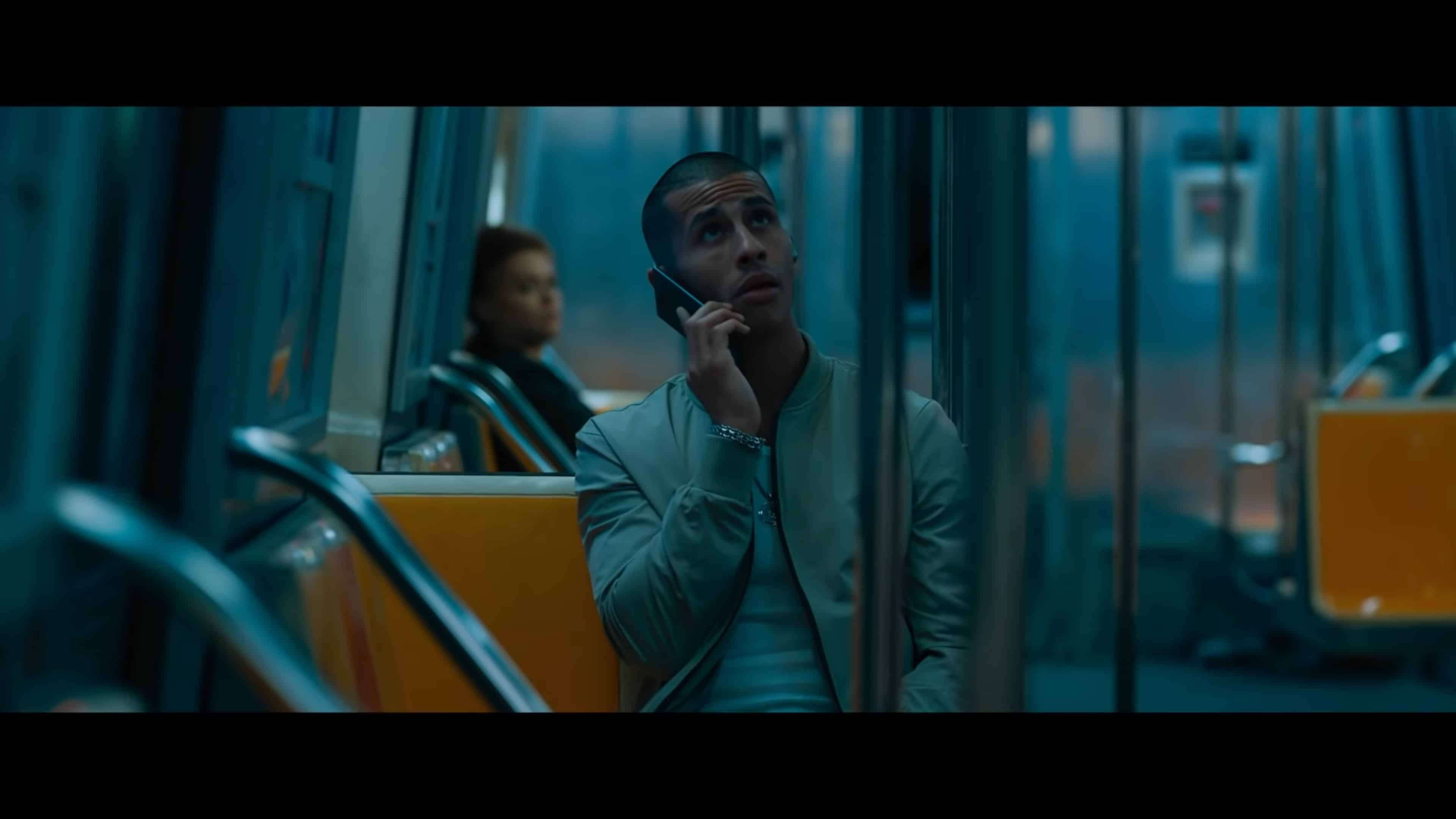Theo (Carlito Olivero) on the phone with his wife