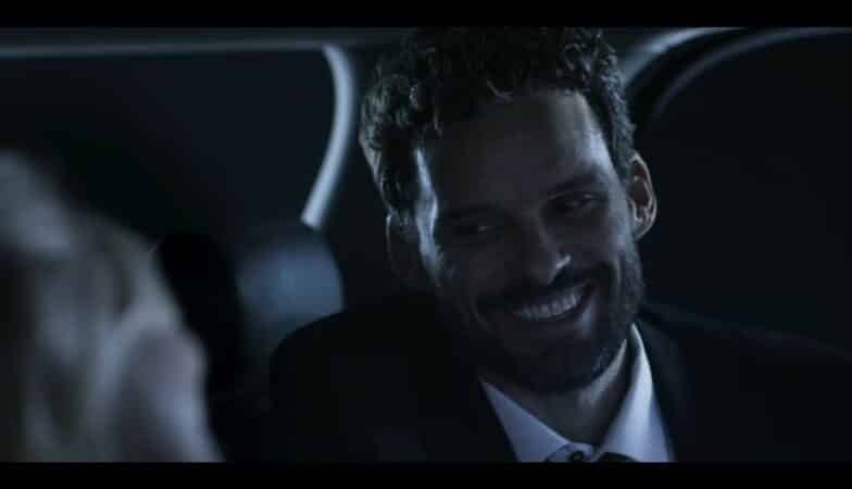 Daniel (Austin Nichols) laughing with his wife, after her charity event