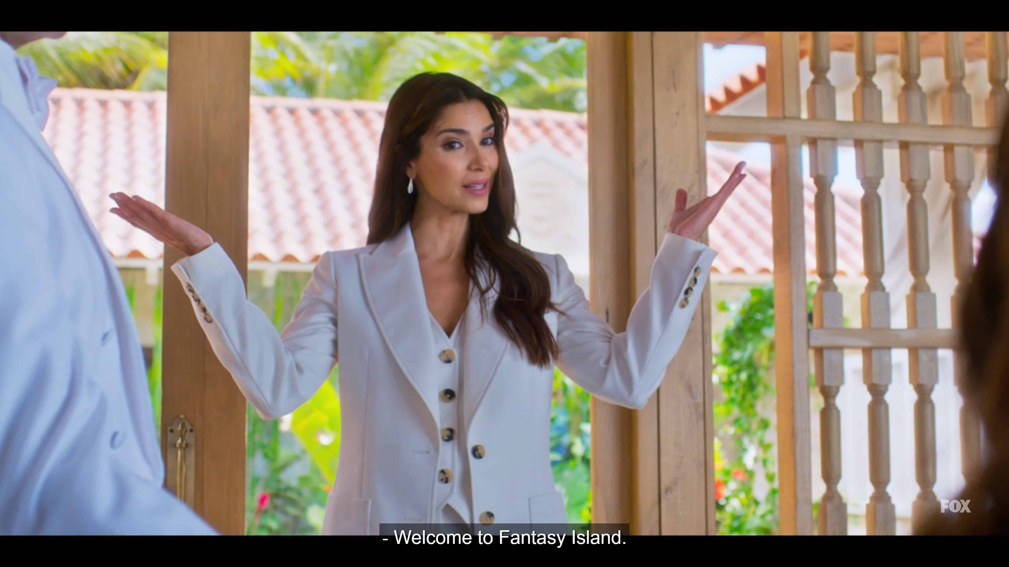 Elena (Roselyn Sanchez) welcoming her guest to Fantasy Island