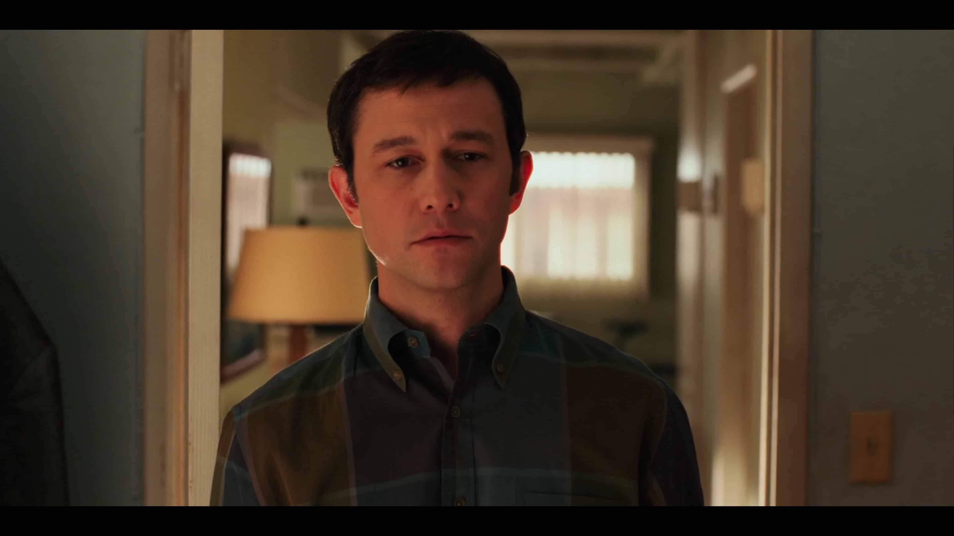 Josh (Joseph Gordon-Levitt) looking at his musical instruments