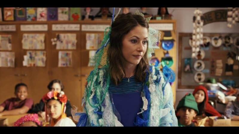 Ms. Perry-Geller (Amanda Crew) teaching Mr. Corman's class
