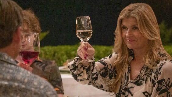 Nicole (Connie Britton) toasting