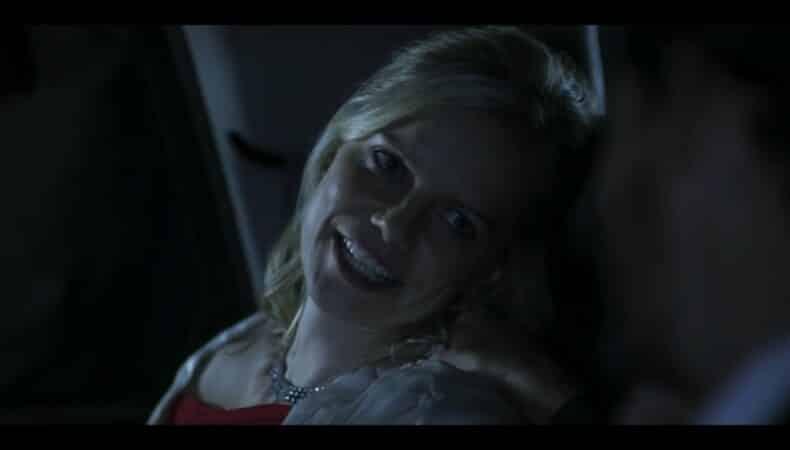 Olivia (Mircea Monroe) in Rose's car, joking with her husband