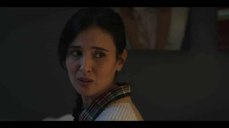 Sofia (Joana Metrass) trying to get Casey to switch the movie they watch