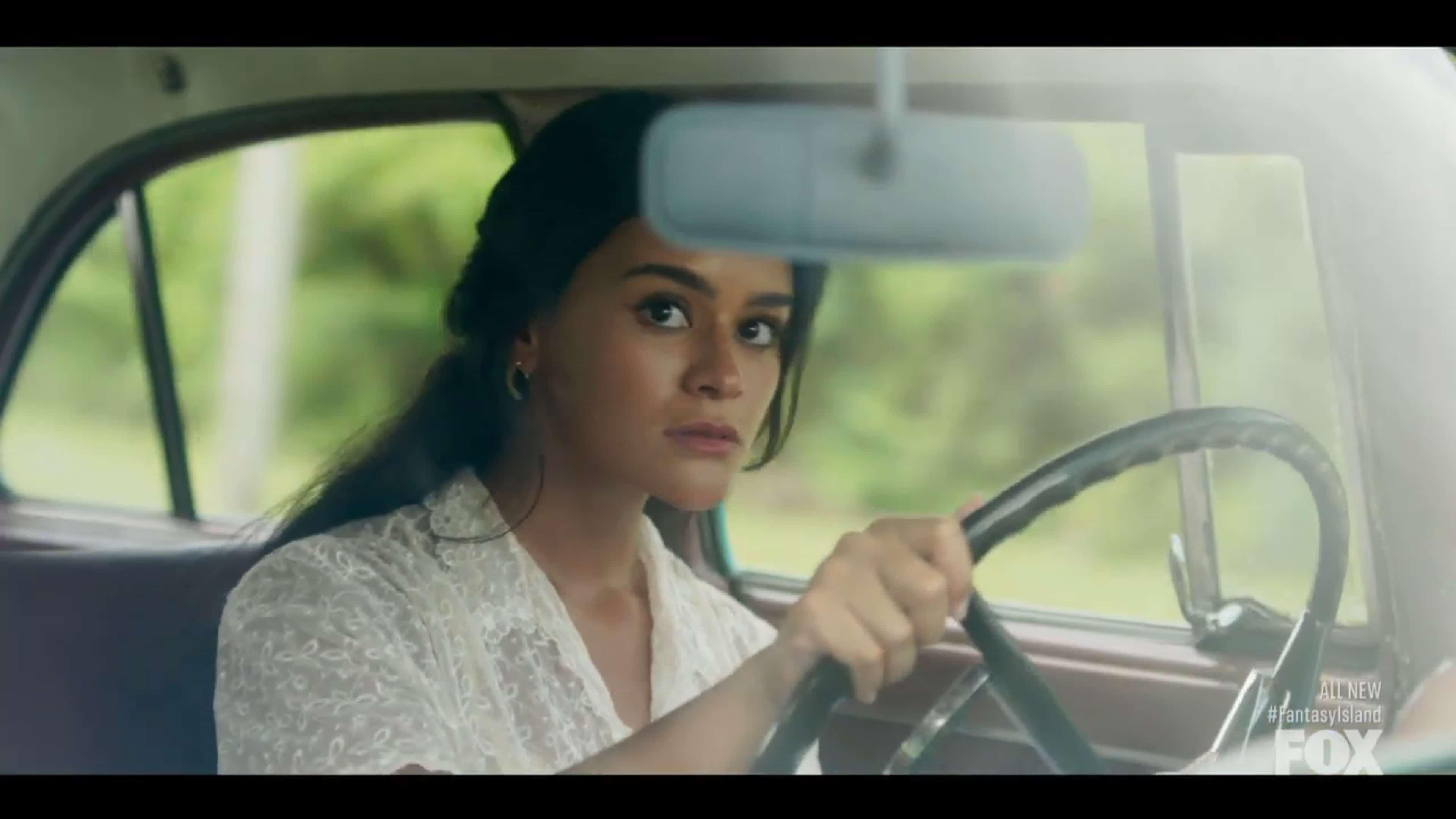 Alma (Gigi Zumbado) driving her grandfather's car in Cuba