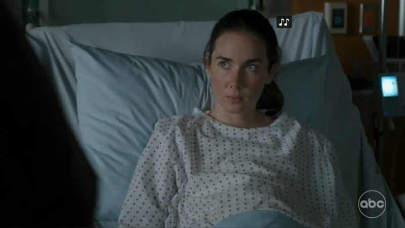 Abby (Lyndon Smith) in a hospital bed